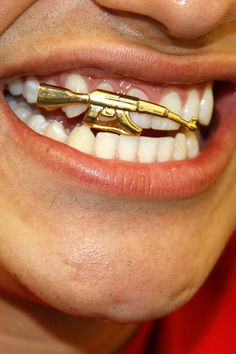 18K Gold Braces Punk Hiphop Single Teeth Grillz Crown Cross Gun Dental  Mouth Fang Grills Tooth Cap Cosplay Party Rapper Jewelry Wholesale Single Grillz  Gold ... 5651a75c3