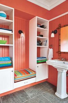 Energizing red amps up the style in a bathroom-seating nook. | Clementine, @California Paints