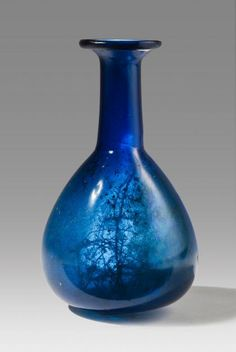 Roman blue glass bottle, c. 1st-2nd century AD
