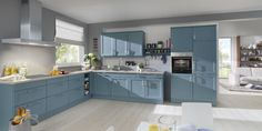 The light blue cabinets & white walls create a light, fresh feel in this modern country kitchen. #Schüller