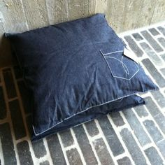 Jeans pillow with a pocket