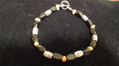 Items similar to Black Faceted and Orange Stone with Silver Spacer Bracelet on Etsy Orange Stone, Craft Items, Beaded Bracelets, Silver, Etsy, Black, Jewelry, Jewellery Making, Black People