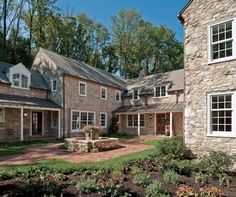 Visitors are greeted by a formal courtyard garden paved with antique brick.