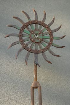 want these 5 ft Industrial Flower Garden Sculpture by SalvageArtGarden, $268.00