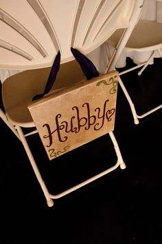 "DIY sign ""hubby"" to hang on groom's chair at wedding reception table"