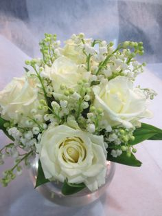 Divine delicate vase arrangement of Lily of the Valley and roses