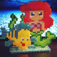 No need to go Under the Sea to find this treasure! A cute perler bead stand up with Ariel in her mermaid form and her guppy Flounder in an ocean