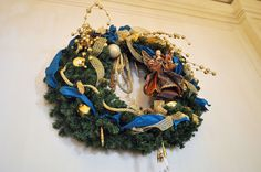Winter Wonder Wreath Beneva Flowers is proud to be the house florist of the Ritz- Carlton: Sarasota. This year's Christmas decor featured gold, navy and green. #Sarasota