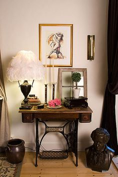 Small window: My mom has one of these antique sewing machines... lovely vignette!
