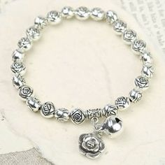 Silver Rose Bead Stretch Bracelet with a Bell Charm