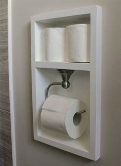Between the studs, create a recessed area for your toilet paper with this bathroom remodel tutorial. More Remodeled Bathroom Ideas | Inspiring Makeovers on a Budget on Frugal Coupon Living. #BathroomRemodeling