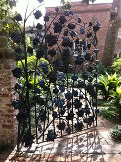 The most beautiful garden gate, look closely and find the woodpecker.