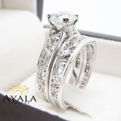 A unique diamond sits atop in breathtaking detail. This art deco bridal ring set also includes a diamond encrusted wedding band that fits within the design for a seamless look when worn. Bridesmaid Jewelry Sets, Bridal Jewelry Sets, Bridal Rings, Wedding Rings, Wedding Band, Bridal Sets, Engagement Ring Guide, Unique Diamond Engagement Rings, Vintage Engagement Rings