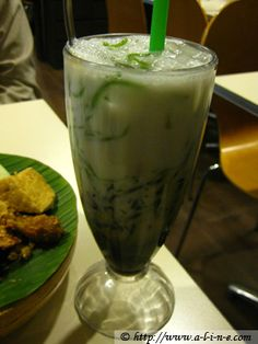 Chendol...an indonesian beverage.   Coconut, palm sugar, ice and smooth jelly bits