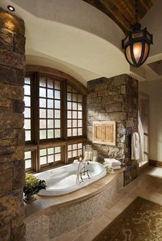 Already see myself in that large tub... loving stone wall as well :)))