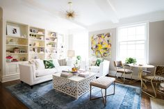 Eclectic Traditional Living Room: Window lit seating area with large white sectional and leopard print chairs.  .