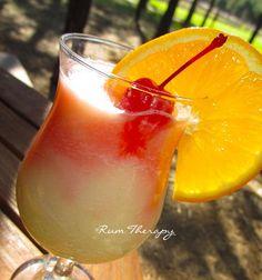 Island Delight: Coconut Rum, Piña Colada Mix, Orange Juice, Grenadine, Orange Slice, Maraschino Cherry.