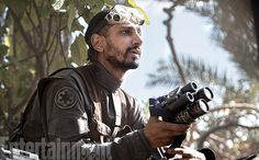 **** Spoiler ****** Riz Ahmed as Bodhi Rook, a pilot from the Force-sacred world of Jedha who was conscripted into service by the Imperials before stealing away to join the Rebellion.