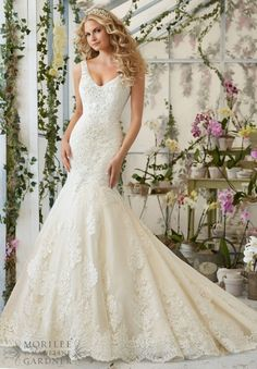 Wedding Dress 2814 Crystal Beaded Embroidery Cascades onto the Tulle Gown with Alencon Lace Appliques and Scalloped Hemline