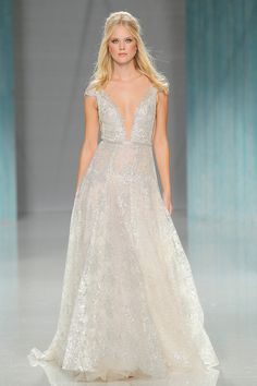 """Silver-grey sexy wedding dress with fine lace detail and dreamy patterns // In our second feature on our favourite designers at Barcelona Bridal Fashion Week 2017 which we covered as an Official Media partner, we fix our gazes on Galia Lahav's bohemian Gala No. IV line and dramatic Victorian Affinity 2018 collection. The standout pieces for us on the catwalk? """"Thelma"""", a homage to Queen Victoria's wedding gown with sheer drape silk tulle sleeves and """"Liliya"""", a fairytale ball gown made of…"""
