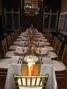 Thanksgiving Party 2014 - Banquet Seating with Gold Chiavari Chairs and Ivory Chair Pads, Ivory Satin Linens, Gold Sequin Runners, Orange Satin Napkins, Gold Charger Plates   Fairy Tale Tents & Events