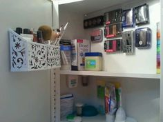 Instead of making a new magnetic board for my makeup & taking up wall space, I'm using the back of my medicine cabinet. I put magnetic strips on the back of my eyeshadows, blush, etc... I even put a magnetic strip on the back of my floss. I even found magnetic pencil holders, for the inside door to hold my makeup brushes & lipgloss.TB
