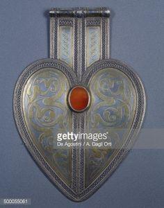 Asyk, women's back pendant in fire-gilded silver and carnelian, Tekke Turkmen, Central Asia