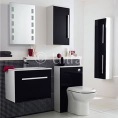 The 600 x 400mm high gloss black and white wall mounted unit with ceramic basin from Ultra, make the most of your bathroom with our modern and practical furniture options. Features a high quality rectangular ceramic basin and a soft-close metal box drawer.