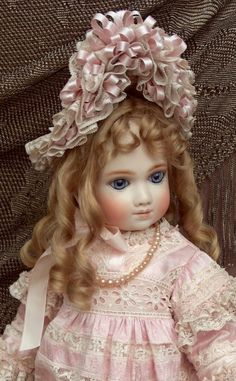 """French Doll by A. Thuillier marked A9T, 22"""" Tall.  An original A. Thuiller doll is very RARE, made in about the 1880's.  The antique doll is very valuable,  it is worth between $68.000.00 to $90,000.00. Rarely found in personal collections,  most of these dolls are found in museums."""