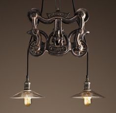 Restoration Hardware barn trolley light (love it)--  we are going to build our own out of the trolley pulleys we bought and save some serious change