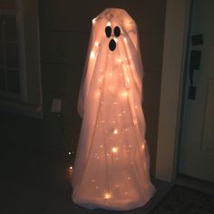 Tomato cage turned upside down - Christmas lights - sheet = BOO!!! Happy Halloween!