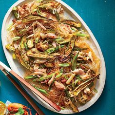Spread Louisiana favorites—lightly charred okra, seared tasso ham, sweet and juicy crab—over a skein of wok-fried cellophane noodles in this East