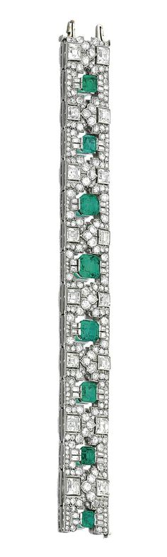 EMERALD AND DIAMOND BRACELET, VAN CLEEF & ARPELS, CIRCA 1922  Estimate:   80,000 - 140,000 CHF   LOT SOLD. 164,500 CHF  (Hammer Price with Buyer's Premium)  Composed of eight graduated step-cut emeralds, set within a geometric border of circular-, single-, step-cut and baguette diamonds, mounted in platinum, length approximately 180mm, signed Van Cleef & Arpels  Paris and indistinctly numbered, French assay and maker's marks, case.