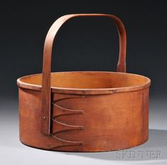 Shaker Round Carrier, Pittsfield, Massachusetts, red-stained bent maple sides with four-finger joinery with lapped rim band, shaped ash swing handle, (minor imperfections), ht. to top of rim 5 1/8, dia. 11 3/4 in.