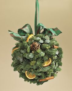Evergreen Orange Kissing Ball - love this too, but we could call it something else. More