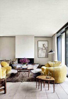 curvy mustard yellow velvet sofas, danish modern nesting tables, modern fireplace, wide plank flooring, modern floor lamp