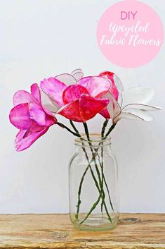 How to make fabric flowers from old bed sheets. It is very easy to upcycle plain cotton sheets into gorgeous flowers for your home. Use sharpies to make watercolor petals in any color you like. #diyflowers #fabricflowers