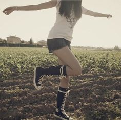 Me wearing my black knee high converse with shorts in the mid field I'm on a holiday to New Orleans and I've only bright pairs of knee high converse to wear for my trip and I'll post pics of my knee high converse during my trip hope you enjoy them!