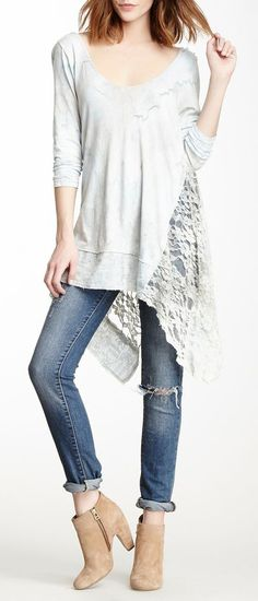 shirt no longer available to buy, but would be an interesting sewing project, whole back is lace attatched to front of a shirt with lace accents. would be cute to try to make it.