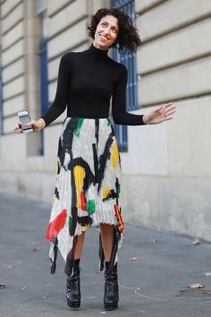 PFW Street Style Day Two: Yasmin Sewell tempered artsy pleats with a classic turtleneck.  Source: Tim Regas