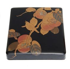 Black lacquered writing box (suzuribako), the lid decorated with birds perched on a branch with persimmons (kaki) in silver and gold raised maki-e lacquer with some red, inside the lid similar persimmons on sprinkled gold (nashiji) lacquer. The box with sprinkled gold-lacquer (nashiji) contains a water-dropper and an ink-stone. Taisho period  H.: 4,3 cm, 20,5 x 23,5 cm.