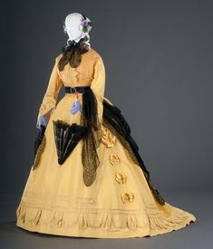 Day Ensemble, c. 1867, by Madame Merlot-Larcheveque. FIDM. The brilliant aniline-dyed color of this silk faille and taffeta gown was fashionably termed sulphur yellow