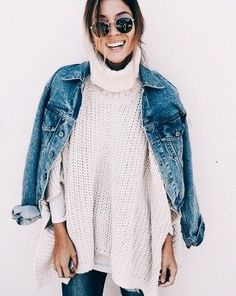 Oversized white knit sweater with denim jacket and jeans.