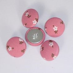 """Superb Quality Fabric Covered ButtonsPacks of 5 or 10 buttons (subject to availability)Each button is 20mmFabric on metal shellLoop shank.Ideal for dressmaking, craft, jewellery or curtain headers etc.Note:Can be supplied without shank / flat metal back. Please email.Exact positioning of the pattern may vary slightlyLocally made, and unbranded, using fabric as described.SaveNeed more than 5 buttons? Use the """"10 button"""" option where available"""