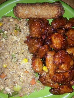 Homemade Chinese food General Tso's Pork and Chicken with veggie fried rice and egg rolls