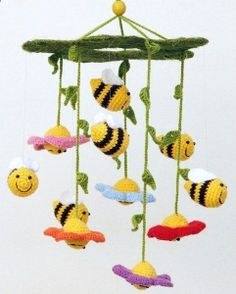 crochet baby mobile with flowers and bees - colorful nursery decor.