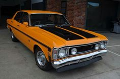 XW GTHO Phase 2 Falcon. The National Concourse winner sells for a record $AU 500K ($380K US) Australian Muscle Cars, Aussie Muscle Cars, American Muscle Cars, Chevy Motors, Ford Girl, Ford Falcon, Performance Cars, Road Racing, Amazing Cars