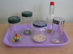 Five Senses - shaker jars for hearing / sound. Another fun activity would be to have the children draw/paint until the music stops, then start again as a small group activity.
