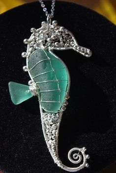 Stunning Sea Horse and sea glass.