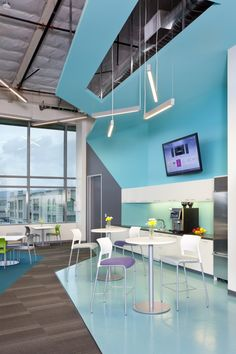 Sharp angles and blue nautical elements in this #breakroom #design by RMW architect & interiors for Navis in Oakland  #workplacedesign #interiors #cafeteria #diningtable  Photo by Michael O'Callahan